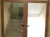 Puerta doble aluminio cerramiento escalera
