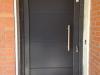 Puerta de calle de pvc gris antracita panel IP7 3 line