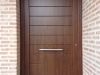 Puerta de calle PVC nogal panel IP7 10 line