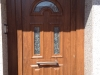 Puerta de calle PVC imitación madera panel IP4 3 vidrios