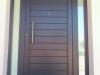 Puerta de calle PVC gris antracita panel IP7 con dos fijos laterales