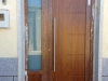 Puerta de calle PVC imitación madera panel Valga