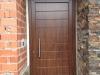 Puerta de calle PVC imitación madera panel IP7 con fijo superior