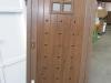 Puerta de calle PVC imitación madera panel IP3C 1V REJA CLAVOS