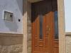 Puerta de calle PVC imitación madera panel COPA