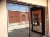 Puerta paralela gris antracita exterior